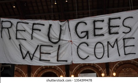 "A hand made banner with words ""refugees welcome"", made of bedsheets"