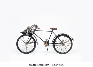 Hand made black bicycle model isolated on white background