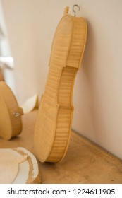Hand made body of Cello, or violoncello, at musical craftmans workshop before completion