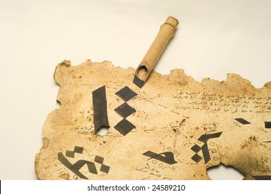 Hand made calligraphy pen and Arabic characters on antique paper
