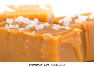 Hand made caramel toffee pieces with sea salt macro with selective focus