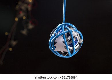 Hand made Christmas bauble made of USB cables, decorated with Christmas paper craft tree