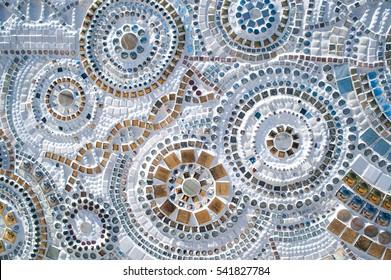 Hand made circular mosaic on Thai Buddhist Temple floor.