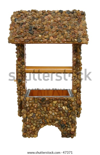 Hand made craft project (no copyright).  Wishing well covered in pebbles used as planter.
