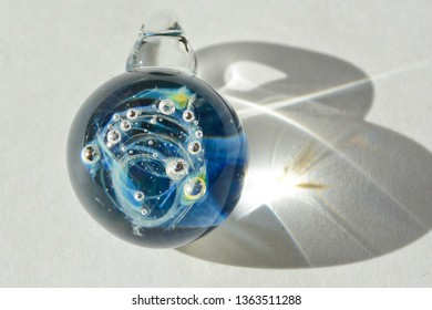 A hand made galaxy glass pendant with pure silver  for the planets. Lampwork using very strong glass,borosilicate.