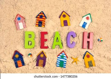 Hand made Miniature beach huts in sand