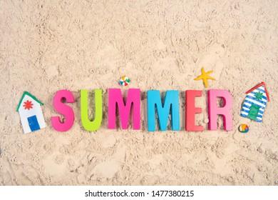 Hand made Miniature beach huts in summer sand
