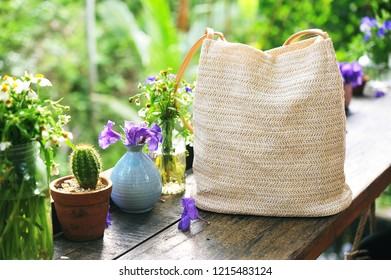 Hand made of natural bag on table.Travel concept.