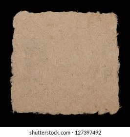 Hand made paper from hemp fibers. Coarse, rough-edged and fibrous. Isolated on black background.