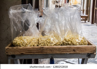 Hand made pasta in the streets of Bari, Italy.