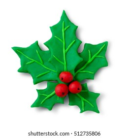 Hand made plasticine figure of Christmas Holly with shadow on white background.