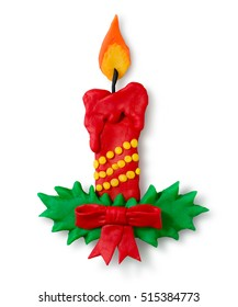 Hand made plasticine figure of Christmas candle with shadow on white background.