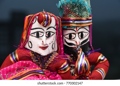 Hand made puppets attached to string, King and queen in Rajasthan India. Dolls men and women face wearing traditional dress saree or sari, Kurta  for plays, dance for Dussehra, Dasara, Diwali festival