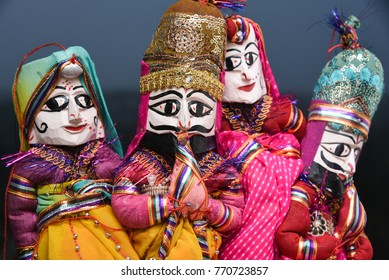 Hand made puppets attached to string in Rajasthan India. Dolls men and women face wearing traditional Indian dress Saree or Sari, Lehenga for plays, dance at Dilli Haat for Dussehra, Diwali festival