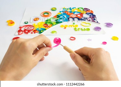 Hand made quilling paper spiral element with instrument