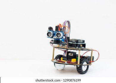 Hand made robot working on the arduino platform. White background. Free space for text. STEM education for children and teenagers, robotics and electronics. DIY. AI. STEAM.