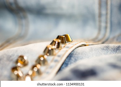 Hand made silver and golden studs on a bleached denim jacket. Rock, punk, metal style.