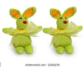 Hand made tiny green knitted rabbits for ornamental pattern