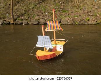 Hand made toy sailboat at river