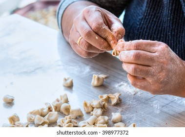 hand made turkish manti getting prepared on table