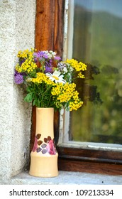 hand made vase with forest flowers