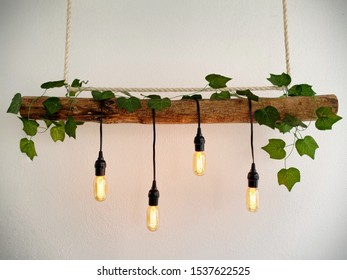 Hand made wooden lamp with hanging vintage Edison bulbs