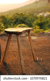 Hand made wooden stool standing outside