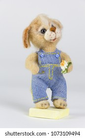 hand made wool toy a dog beagle farmer with summer flower in jeans denim jumpsuit