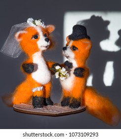 hand made wool toy fox couple bride and groom marriage with wedding flower isolated