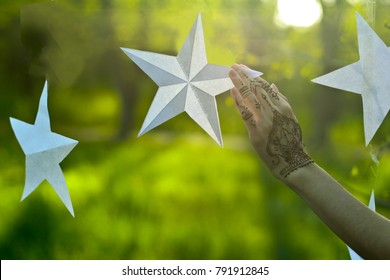 Hand with mahndi and stars in the spring