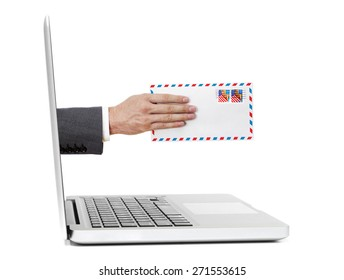 Hand with mail out of laptop