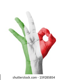 Hand making Ok sign, Italy flag painted as symbol of best quality, positivity and success - isolated on white background