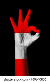 Hand making Ok sign, Peru flag painted as symbol of best quality, positivity and success - isolated on black background
