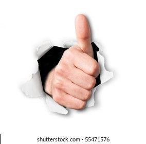 Hand making thumbs up sign breaking through a thin wall or paper, isolated on white