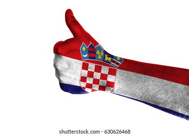Hand making thumbs up sign. Croatia painted with flag as symbol of thumbs like,up,okay. Isolated on white background.