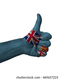 Hand making thumbs up sign, fiji painted with flag as symbol of thumbs up, like, okay, positive  - isolated on white background
