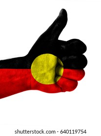 Hand making thumbs up sign.Australian Aboriginal painted with flag as symbol of thumbs like,up,okay. Isolated on white background.