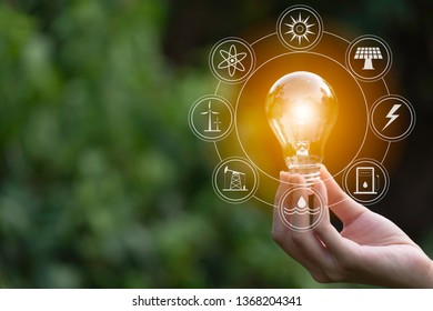 Hand of male holding a light bulb and copy space. Ideas and creative concept.