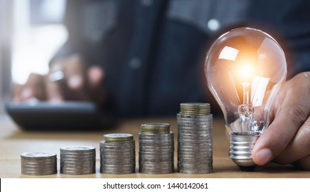 Hand of male holding a light bulb and copy space for accounting, ideas and creative concept.