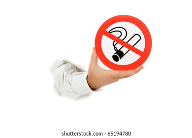"Hand of man breaking through a paper wall and showing ""no smoking"" sign. Copy space. Studio shot. White background."