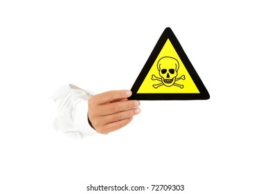 "Hand of man breaking through a paper wall and showing warning sign ""hazardous/toxic material"". Copy space. Studio shot. White background."