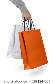 hand of man carrying shopping bags on white background