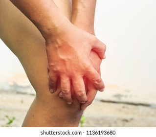 hand of man is catch knee for Pull up  on white background