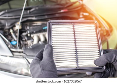 Hand a man change and check air filter of car in the engine room
