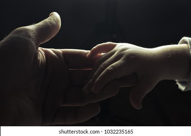 hand of man and child,God's help