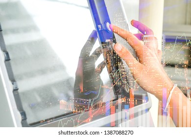 Hand of a man with a credit card, using an ATM. Young woman withdrawing money from credit card at ATM, Stock market or forex trading graph and candlestick chart suitable for financial investment.