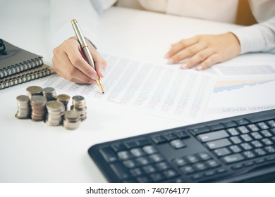 Hand man doing finances and calculate on desk about cost at home office.Concept finances and economy