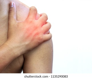 hand of man holding his shoulders with shoulder pain on white background. Health care Concepts