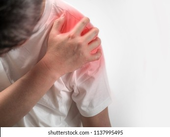 Hand of man holding his shoulders with shoulder pain on white background, Enhanced skin with red spot indicating location of the pain,Pain in the shoulder with red dot.