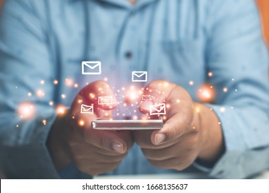 Hand man holding smart phone with icon envelope email send mail and data.concept email